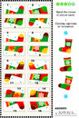 Visual puzzle match the halves socks of cards depicting colorful christmas answer included Stock Photos