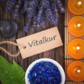 Vitalkur vital cure perfumed candles with lavender leaves and label with german text curel Stock Photography