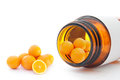 Vitamin c miniature oranges inside a pill container Stock Photos