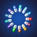Vitamin pills on blue background Royalty Free Stock Images