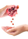 Vitamin pills conceptual image of tablets being squeezed out of a pomegranate fruit a powerful antioxidant Stock Photos