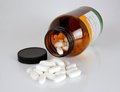 Vitamin pills on the glossy background Royalty Free Stock Photos