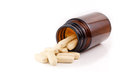 Vitamin pills view brown bottle on side Royalty Free Stock Photo