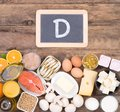 Vitamine D food sources, top view on wooden background Royalty Free Stock Photo