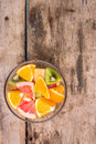 Vitamins mix background fresh fruit salad on wooden table top view image Royalty Free Stock Photos