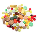 Vitamins pills and tablets on white Royalty Free Stock Photography
