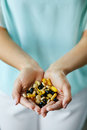 Vitamins And Supplements. Woman Hands Full Of Medication Pills Royalty Free Stock Photo