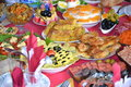 Vittles dishes on the table covered with delicious food Royalty Free Stock Images