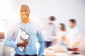 Vivacious bearded guy with folder on blurred double exposed background Royalty Free Stock Photo