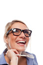 Vivacious woman enjoying a good laugh closeup portrait of beautiful wearing heavy rimmed glasses while holding pen in her Stock Images