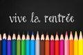 Vive la rentree (meaning Back to school) written on black chalkboard background