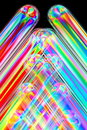 Vivid color composing thin tubes of transparent plastic seen in polarised light they ared arranged diagonally in the picture and Stock Photography