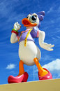 Vivid colored figure daisy duck part huge private collection seen here sitting wall one her typical poses blue sky background Royalty Free Stock Images