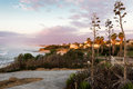 Vivid colorful evening sunset sea shore village town view. Royalty Free Stock Photo