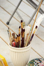 Vivid paintbrushes at the atelier big mix of and art palette artist workplace Royalty Free Stock Images