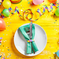 Vivid yellow carnival place or table setting Royalty Free Stock Photo