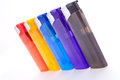 Vividly coloured plastic lighters Royalty Free Stock Images