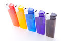 Vividly coloured plastic lighters Royalty Free Stock Photography
