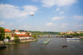 Vltava river in prague the with some boats and a bridge the background czech republic Stock Image
