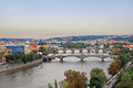 Vltava river in prague view at bridges and at sunset Stock Photos