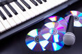Vocal microphone,cd discs and electronic keyboard Royalty Free Stock Image