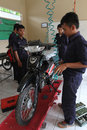 Vocation school vocational students practice repairing a motorcycle engine in the city of solo central java indonesia Stock Photos