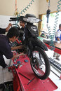 Vocation school vocational students practice repairing a motorcycle engine in the city of solo central java indonesia Royalty Free Stock Image
