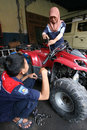 Vocation school vocational technical students practice with the machine repair all terrain vehicle at a workshop in solo central Stock Images