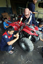 Vocation school vocational technical students practice with the machine repair all terrain vehicle at a workshop in solo central Royalty Free Stock Image