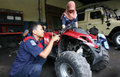 Vocation school vocational technical students practice with the machine repair all terrain vehicle at a workshop in solo central Stock Photo
