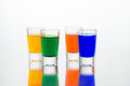 Vodka color  shots filled with alcohol on glass bar table Royalty Free Stock Photo