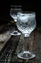 Vodka a glass of on a wood background Stock Photography