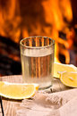 Vodka with lemon on the background of fire Royalty Free Stock Image