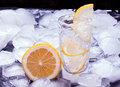 Vodka with lemon poured in a glass made of ice Royalty Free Stock Photography