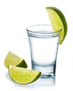 Vodka shot glass of with fresh lime isolated on white background Royalty Free Stock Photos