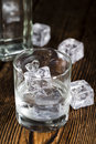 Vodka shot of ice cold on rustic wooden background Stock Images