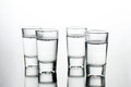 Vodka shots filled with alcohol on glass bar table Royalty Free Stock Photo