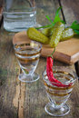 Vodka two glasses of and pickles on the table Royalty Free Stock Photo