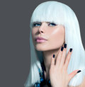 Vogue style model portrait girl with white hair and black nails Royalty Free Stock Image