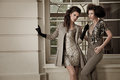 Vogue style photo of a two fashion ladies Royalty Free Stock Photo
