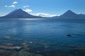 Volcanic atitlan lake in guatemala with a small boat Royalty Free Stock Photos
