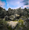 Volcanic basalt lava landscape iceland of field with sharp black rocks covered with green moss a wild geologic rock formation with Royalty Free Stock Photos