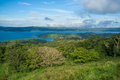 Volcanic lagoon arenal surrounded by lush tropical vegetation costa rica Royalty Free Stock Photography