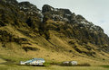 Volcanic mountains with an icelandic school in foreground Royalty Free Stock Image