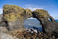 Volcanic rock arch in Iceland Royalty Free Stock Image