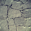 Volcanic rock wall stone taken on mobile phone camera with added instagram style filter effect Stock Photography