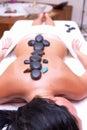 Volcanic stone massage Royalty Free Stock Photo