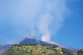 Volcano etna panoramic view of the early in the morning with a blue sky Royalty Free Stock Photo
