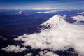 Volcano in kamchatka above the clouds russia Stock Photos
