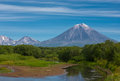 Volcano Koryaksy and river Avacha on Kamchatka. Royalty Free Stock Photography